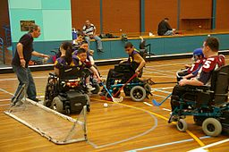 Youth Playing Power Hockey Using Wheelchairs.
