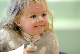 Young Smiling Girl With Tracheotomy