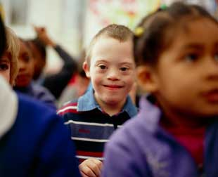 Six-year-old boy with Down syndrome with fellow pupils in a school setting