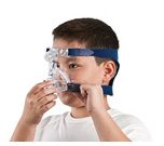 Boy in ResMed Micro for Kids nasal mask